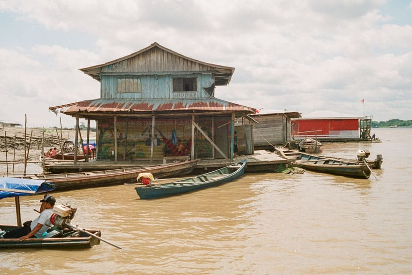 Houseboat and boats in Brazil - Amazon Travel Story on 35mm by Christopher Godley on Shoot It With Film