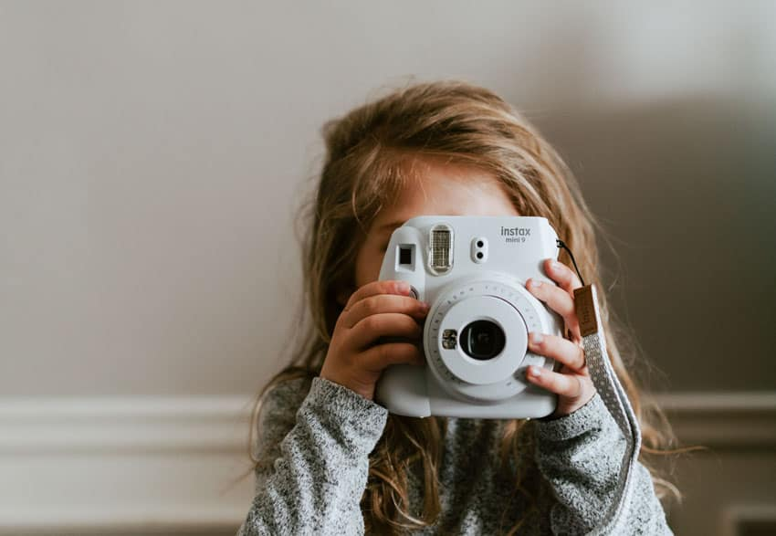 Child Holding the Instax Mini - Photography Activities for Kids with the Instax Mini on Shoot It With Film