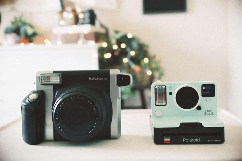 Polaroid OneStep 2 vs Fujifilm Instax Wide 300 by Samantha Stortecky on Shoot It With Film