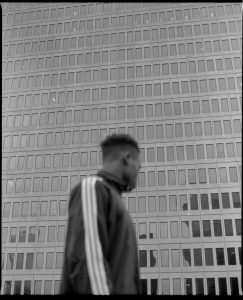 Man Outside of Skyscraper - Creative Portraits on Film by Zerb Mellish on Shoot It With Film