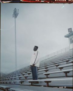 Man Standing on Stadium Bleachers - Creative Portraits on Film by Zerb Mellish on Shoot It With Film