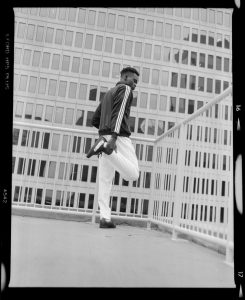Man Stretching Outside of Building - Creative Portraits on Film by Zerb Mellish on Shoot It With Film