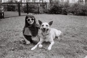 Black and white image of a girl and her dog - 5 Film Cameras Under 50 Dollars by Jennifer Stamps on Shoot It With Film