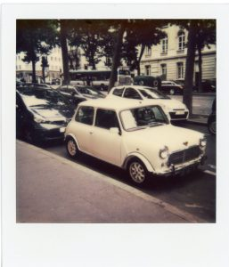 Polaroid picture of a vintage car - 5 Film Cameras Under 50 Dollars by Jennifer Stamps on Shoot It With Film
