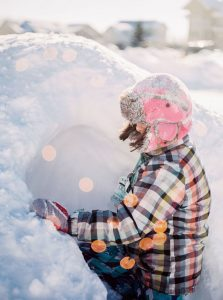 Girl playing in the snow - 6 Film Photography Tips for Beginners by Samantha Stortecky on Shoot It With Film