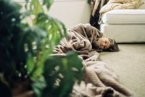 Girl curled up in a blanket on the floor - 6 Film Photography Tips for Beginners by Samantha Stortecky on Shoot It With Film