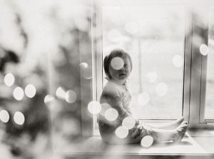 Baby sitting by a window - 6 Film Photography Tips for Beginners by Samantha Stortecky on Shoot It With Film