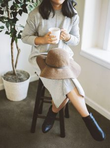 Woman sitting on a stool drinking coffee - 6 Film Photography Tips for Beginners by Samantha Stortecky on Shoot It With Film