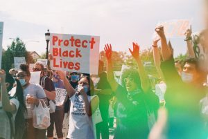 Group of Protesters Holding Signs - Black Lives Matter Protest on Psychedelic Blues Film by Louise Gibson on Shoot It With Film