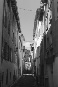 Black and white image of a narrow street - French Catalonia Travel Story by Michael Raven on Shoot It With Film