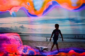 35mm Film Photography Soaked in Film Soup of a Boy Pulling a Boogie Board at the Beach - Interview with Amy Berge of Film Lab 135 on Shoot It With Film