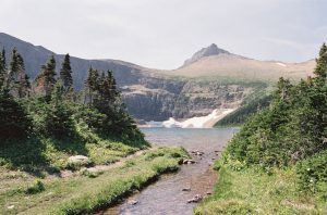 Mountain landscape with trail photographed on 35mm film - Glacier National Park Travel Story by Jill Bridgeman on Shoot It With Film