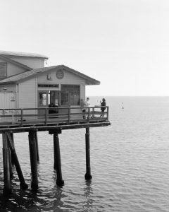 Black and white image of a pier on Ilford Delta 3200 film - Guide to Ilford BW Film by David Rose on Shoot It With Film