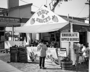 Black and white image of a fruit stand on Ilford FP4 film - Guide to Ilford BW Film by David Rose on Shoot It With Film
