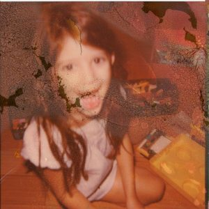 Polaroid image of a young girl laughing - Polaroid Film Soup Experiment by Jennifer Stamps on Shoot It With Film