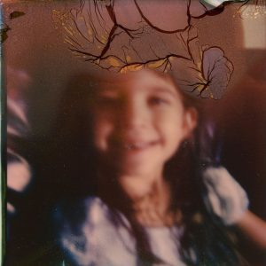 Polaroid image of a young girl smiling - Polaroid Film Soup Experiment by Jennifer Stamps on Shoot It With Film
