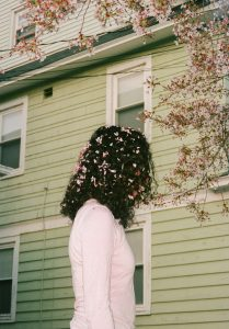 Woman with back turned and flowers in her hair - The Seed I Nurtured Fine Art Series by Chloe Xiang on Shoot It With Film