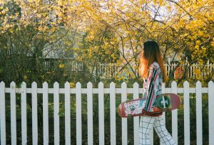 Woman walking down sidewalk with skateboard - The Seed I Nurtured Fine Art Series by Chloe Xiang on Shoot It With Film