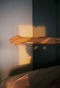 35mm film image of the sunlight on a person's arm - Fine Art Series by Nick Prideaux on Shoot It With Film