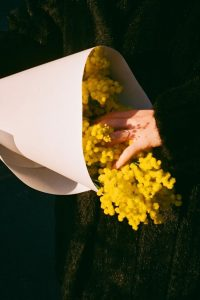 35mm film image of a person holding flowers - Fine Art Series by Nick Prideaux on Shoot It With Film