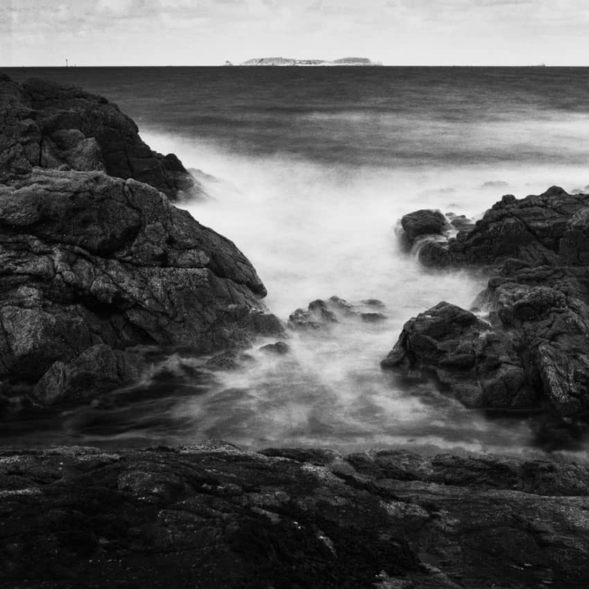 Black and white film photography long exposure of breaking waves - Understanding Reciprocity Failure in Long Exposure Film Photography by James Baturin on Shoot It With Film
