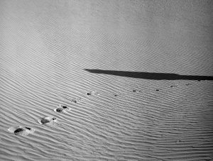Black and white medium format film image of foot prints in the sand dunes in New Mexico - White Sands by Madison Lloyd on Shoot It With Film