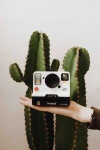 Woman holding Polaroid OneStep 2 - 10 Awesome Gifts for Film Photographers on Shoot It With Film