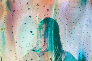 35mm film photography film soup image of the back of a woman's head - 5 Creative Film Photography Projects to Try When You're Uninspired by Amy Berge on Shoot It With Film