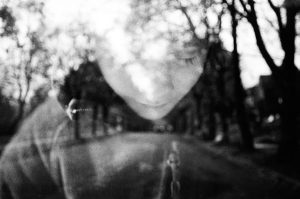 35mm film photography double exposure black and white image of a boy and a city street - 5 Creative Film Photography Projects to Try When You're Uninspired by Amy Berge on Shoot It With Film