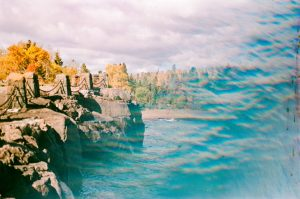 35mm film photography using a prism of cliffs by a lake - 5 Creative Film Photography Projects to Try When You're Uninspired by Amy Berge on Shoot It With Film