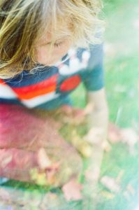 35mm film photography using a prism of a boy playing - 5 Creative Film Photography Projects to Try When You're Uninspired by Amy Berge on Shoot It With Film