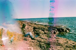 35mm film photography film soup image using a prism of a coastline - 5 Creative Film Photography Projects to Try When You're Uninspired by Amy Berge on Shoot It With Film