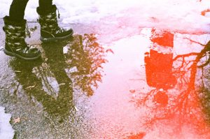 35mm film photography of a puddle with a light leak - 5 Creative Film Photography Projects to Try When You're Uninspired by Amy Berge on Shoot It With Film