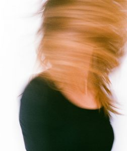 35mm film photography of a woman's hair in motion - 5 Creative Film Photography Projects to Try When You're Uninspired by Amy Berge on Shoot It With Film
