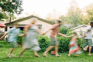 35mm film photography of a family holding hands and running - 5 Creative Film Photography Projects to Try When You're Uninspired by Amy Berge on Shoot It With Film