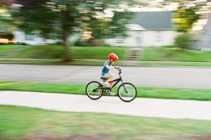 35mm film photography of a kid riding a bike - 5 Creative Film Photography Projects to Try When You're Uninspired by Amy Berge on Shoot It With Film