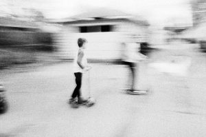 35mm film photography of kids on scooters - 5 Creative Film Photography Projects to Try When You're Uninspired by Amy Berge on Shoot It With Film