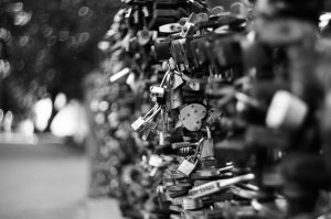 Fence with locks on 35mm black and white film - Eastern Europe Travel Story by Taylor Stoker on Shoot It With Film
