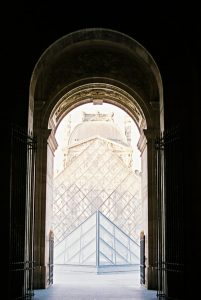 The Louvre through an archway - Paris in Summer 35mm Film Travel Story by Marissa Wu on Shoot It With Film