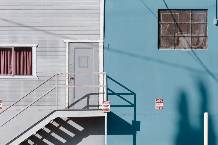 A staircase and door - Los Angles on Ektar 100 by Reza Rostampisheh on Shoot It With Film