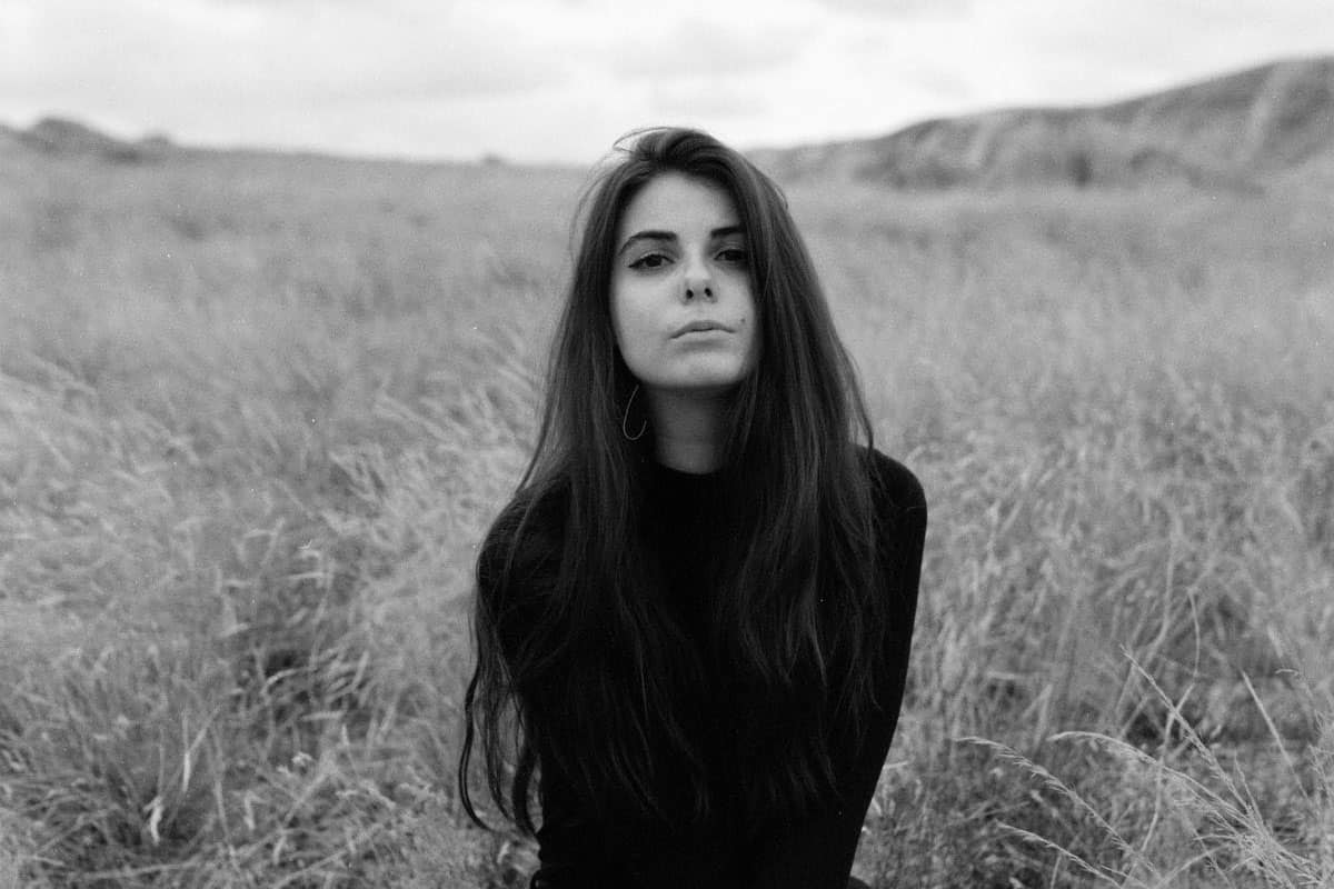 35mm film editorial image of a woman sitting in a field - Crisp Autumn Portrait Series by James Juranke on Shoot It With Film