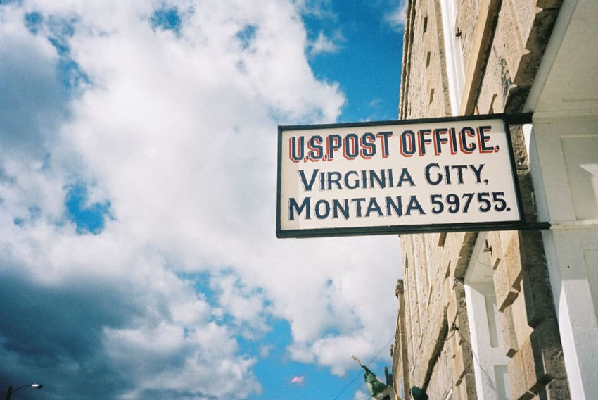 35mm film image of an old fashioned post office sign - Montana Road Trip by Katya Rowny on Shoot It With Film