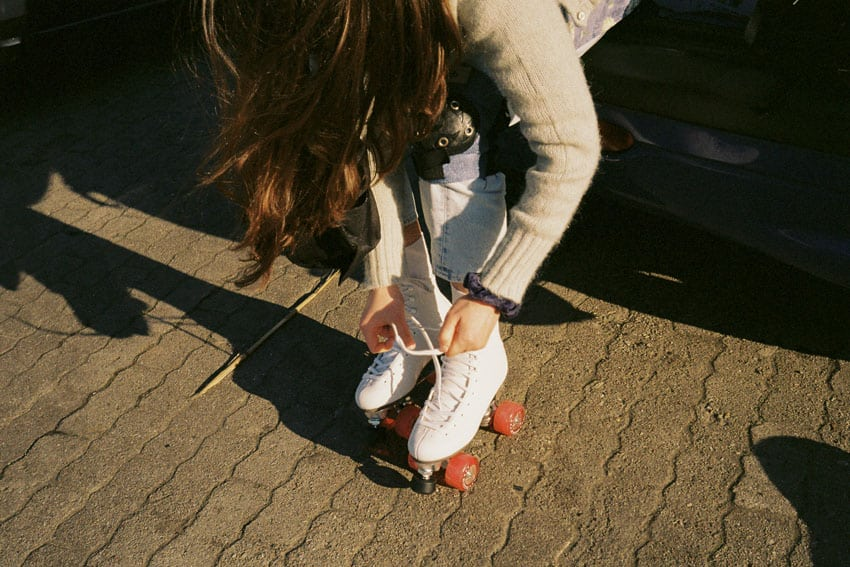 35mm film image of a woman putting on roller skates - Spring in Germany by Christopher Schutte on Shoot It With Film