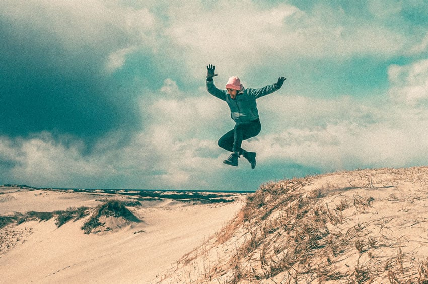 35mm film image of a man jumping on the beach - The Offseason on Cape Cod by Brittany Rolfs on Shoot It With Film