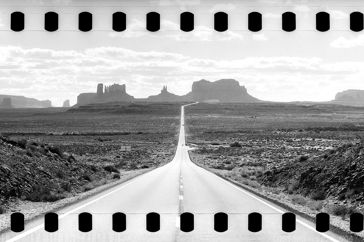35mm panoramic film image with sprockets of a road in the desert - 35mm Panoramic in a Medium Format Camera by David Rose on Shoot It With Film
