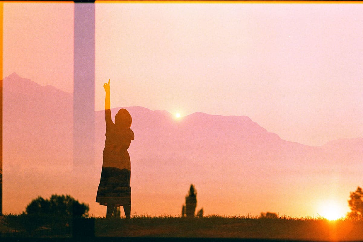 EBS double exposure of a child and the mountains - Experimental Film Photography: A Photo Essay by Cami Turpin on Shoot It With Film